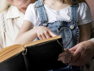 Grandmother and granddaughter reading Bible