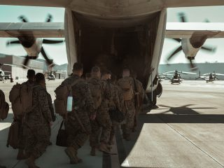 soldiers boarding plane for military deployment