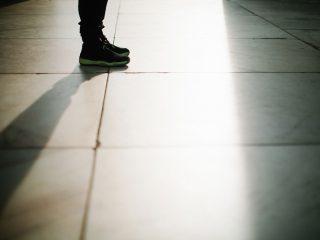 teen standing in shadows