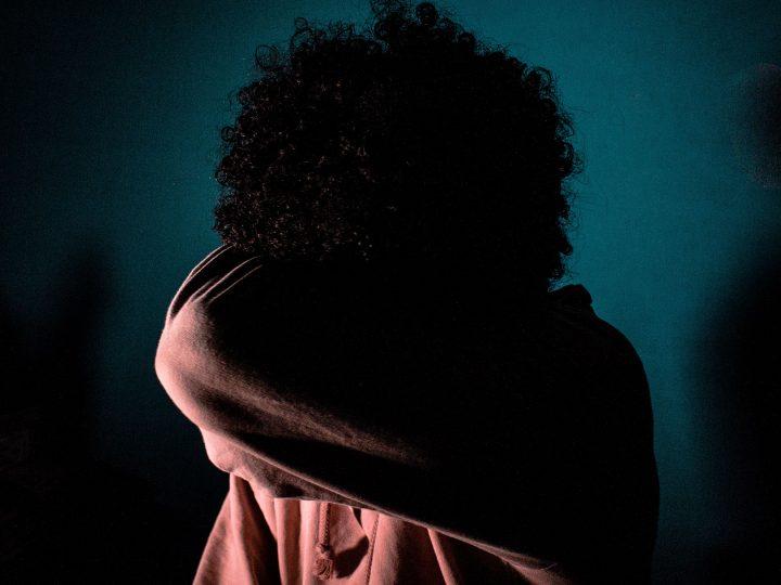 woman hiding her head