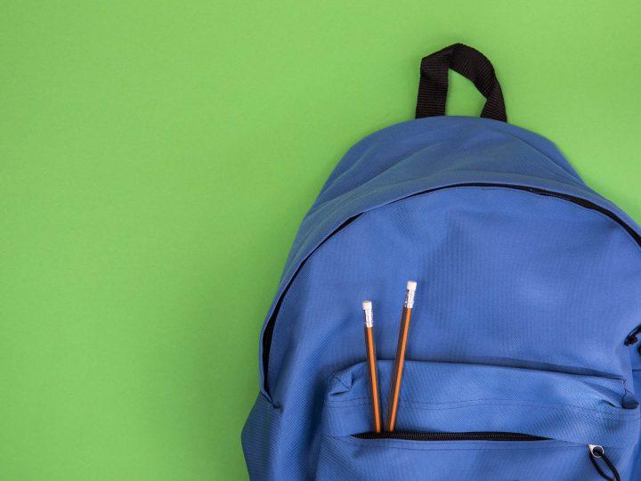 blue school knapsack with pencils